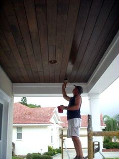 Home Remodeling Outdoor Home Ideas Porch Ceiling Dark Brown Wood Stain - From vaulted to coffered wood, simply paint and beyond, discover the top 70 best porch ceiling ideas. Explore stunning covered space designs for your home. Tongue And Groove Ceiling, Porch Ceiling, Patio Ceiling Ideas, House With Porch, Staining Wood, Ceiling Design, Ceiling, House, Building A Porch