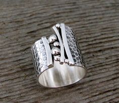 Ring | Delias Thompson. 'Bridges' Sterling silver. - Don't be tricked when buying fine jewelry!