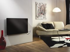 The elegant glass front finish in black of our Girona Panel Heater is only topped by its amazing features - silent operation, splashproof rated electronic thermostat controls, room temperature stability to °C Glass Panels, Art Decor, Stability, Electric, Elegant, Amazing, Black, Spacious Living Room, Heating Systems
