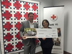 As part of Subaru's Love Promise initiative, Jim Pernas, Zone Director, Portland at Subaru of America Inc., presents a donation of $50,000 to Amy Shlossman, CEO of the American Red Cross Cascades Region to deliver relief to those affected by devastating wildfires in the Pacific Northwest.