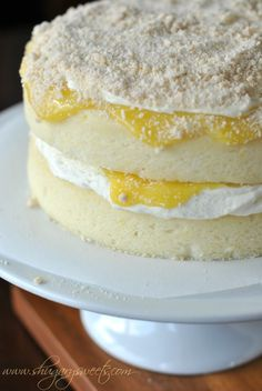 Homemade Lemon Cake with a layer of creamy lemon frosting and fresh lemon curd #cakerecipe #lemon