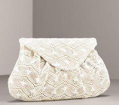 Lauren Merkin Charlotte Crochet Clutch.  This delicate looking bag has a sweet, vintage look. Embellished only by subtle pleating, the crochet pattern gives the bag dimension and interest.