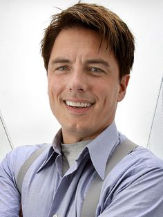 John Barrowman, both pretty and ruggedly handsome. Captain Jack Harkness anyone?