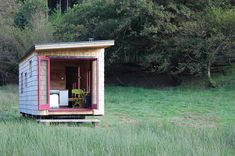 A tiny cabin that you can stay in located in Powys, Wales. http://beudybanc.weebly.com/caban-coch-rolling-cabin.html