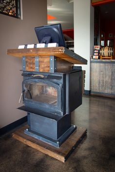 1960's fireplace turned host stand. #finartco #finart #restaurant #design #reuse