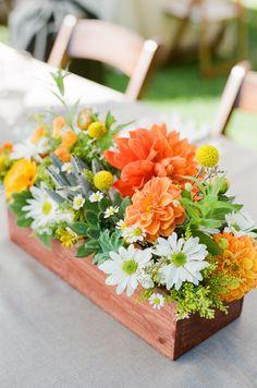 pretty flower wedding centerpieces with orange yellow white and greens. Orlando wedding flowers | www.weddingsbycarlyanes.com