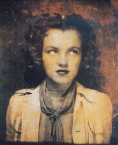 Young, young Norma Jean - ( looks like Foster Care has soured her bright spirit she was born with ) marilyn