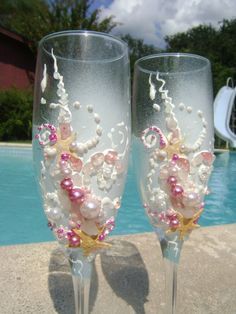Starfish Beach wedding champagne glasses in shades of pink and white for the bride & groom............................... Wedding Tip: Perhaps include special toasting glasses for the parent as well... Wedding tip courtesy of 'The Gold Wedding Planner' iPhone App.