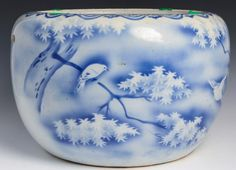 Blue and white paint under glaze Japanese porcelain hibachi with bird and tree design.