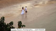 The bride and groom walking on the beach at Couples San Souci, Jamaica. Very beautiful photo of the lovely couple taken from a cliff top. I truly love all of Jamaica. My kinda island. #jamaicaweddingphotographer #ochoriosweddings #negrilwedding #Siestakeyweddingphotographers #sunnyislesbeachweddings #naplesfloridaphotographer #jamaicawedding #miamiweddings#mauiweddingphotographer #cabosanlucasweddingphotographer #stluciaweddingphotographer #barbadosweddingphotographer #stmartinwedding…