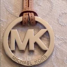 Michael Kors pendent with strap Prefect for mk lovers, can be used as a decorative item, strap is 7in offers welcome and happy poshing and happy holidays Michael Kors Accessories