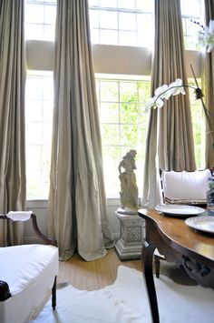 the curtains - - - 2 widths per panel of the gray taffeta and a lining and a blackout lining to provide a certain heaviness for draping, fall softly from the rings, 2-3 inch puddle