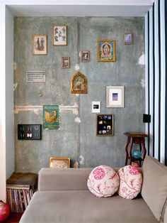 vertical stripes & array of wall decorations, furniture match wall color since everything else so busy