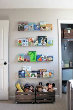 Love the wooden crates for toy storage! Plus all the kids' books on a display wall.