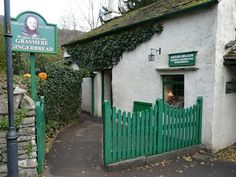The Grasmere Gingerbread Shop tucked away in the corner of St. Oswalds's Churchyard, next to the Wordsworth Hotel in the village of Grasmere, Ambleside, Cumbria. This cottage is famous for it's gingerbread that has been made in this cottage since the Victorian era. The recipe is kept locked in a bank vault.