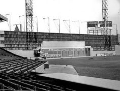 The Green Monster of Fenway Park under construction.
