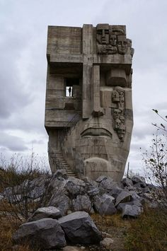 MASK OF SORROW (Russian: Маска скорби, Maska skorbi) is a monument perched on a hill above Magadan, Russia, commemorating the many prisoners who suffered and died in the Gulag prison camps in the Kolyma region of the Soviet Union during the and Street Art, Wow Art, Futuristic Architecture, Building Architecture, Architecture Design, Kandinsky, Brutalist, Of Wallpaper, Land Art