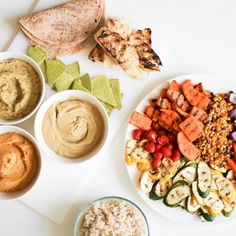 Grilled Vegetables and Hummus Trio including Roasted Garlic, Ginger Carrot, and Rosemary Onion Hummus. Serve with assorted breads!
