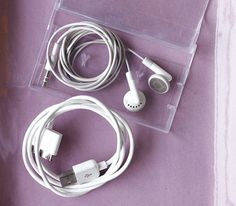 Use an old cassette case to hold headphones and charger...plus other cool reusable ideas