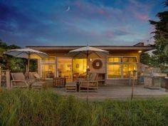 "Bayfront Cottage / 630 sq ft / interior-exterior flow makes it live ""BIG"" / no floor plan; photos here: http://www.frontdoor.com/the-2014-doory-awards-tiny-homes"