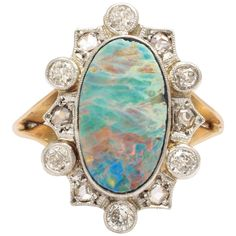 Opal Diamond Gold Platinum Ring | From a unique collection of vintage more rings at https://www.1stdibs.com/jewelry/rings/more-rings/