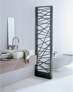 The Mikado from Scirocco is a Japanese influenced screen divider that doubles as a radiator. Perfect for this modern Zen bathroom style.