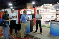 Dovetail Software Reps strike a pose for the booth at the IHRIM Conference    #HR #IHRIM