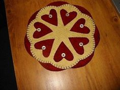 "Offered to you by: Bits of Cloth Hearts This is a new primitive candle mat. I have handcrafted this from woolfelt and hand-sewn all the pieces with great care. The candle mat is 9"" in dia. This is a d"