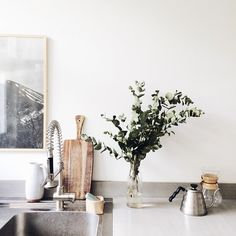 contemporary home | interior design | neutral colors kitchen | indoor plants | wall art | lean and layer | affordable art online