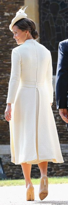 Pippa Middleton wore a bespoke Emilia Wickstead hat, Jane Taylor hat and Charlotte Olympia pumps. http://www.dailymail.co.uk/femail/article-3150081/It-s-glamorous-Aunt-Pippa-Kate-s-younger-sister-shows-slim-figure-chic-50s-style-cream-dress-Charlotte-s-christening.html