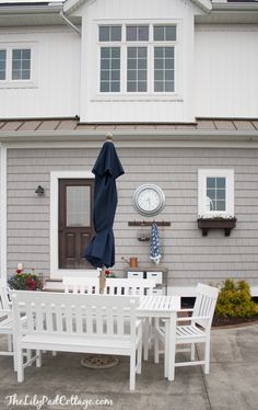 White wooden patio set and navy umbrella - I really like this and it works really well with the deck color we're going with, which is similar to the house color in the bg. House Tour - The Lilypad Cottage