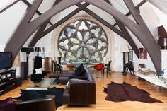This church has been converted into a wonderfully quirky and modern penthouse, but it is perhaps the living room that makes the best use of the original design. Description from sofaworkshop.com. I searched for this on bing.com/images