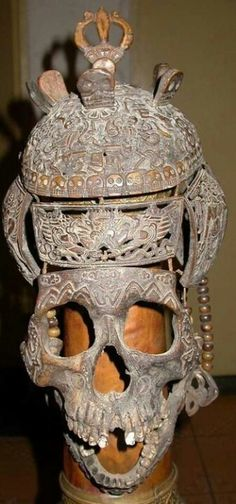 Extremely rare Tibetan shaman's mask formed and carved from bits of a human skull.
