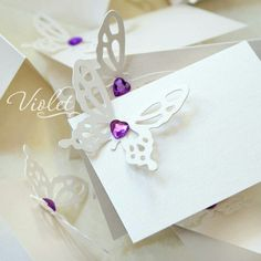 Wedding stationery inspired by those moments when you feel butterflies in the stomach. Blank butterfly place cards, table cards from violet-weddinginvitations.com