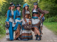 Steampunk Group Costumes Done Right - How to plan, design and create a steampunk group costume for men and women (teal blue and brown) - For costume tutorials, clothing guide, fashion inspiration photo gallery, calendar of Steampunk events, & more, visit SteampunkFashionGuide.com