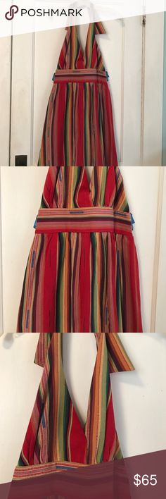 CowGirl Justice Aztec striped dress Super cool CowGirl Justice halter dress dress. Beautiful colors. Reds oranges, yellow gold, greens, blues, greens brown & black. The up & down stripes are slimming. The back of the dress has a lot of stretch to it. So dress could easily fit a size up or down. I wore it with a brown belt. The red Minnetonka wedge sandals also lister would look great with dress. Gently used once. Smoke free home Cowgirl Justice Dresses