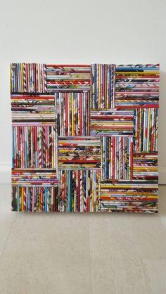 Schilderij gemaakt van rolletjes papier, hiervoor zijn oude magazines gebruikt.