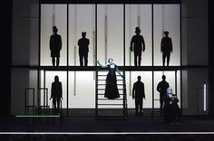 I like the shapes and shadows, with the light from the gauze. From a Robert Wilson production.