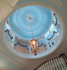 gorgeous rotunda with ceiling dome painted in sky blue with crisp white design; ceiling design