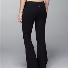 REVERSIBLE Lululemon Groove Pants Great pink and orange band on one side, all black on the other side. Size tag still on as pictured. Good condition - never worn while sweating. lululemon athletica Pants Track Pants & Joggers