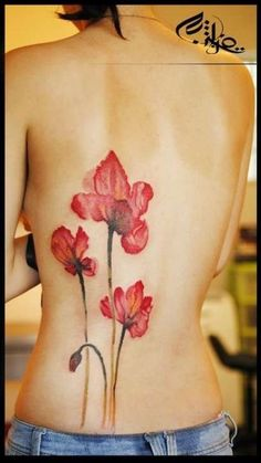 holy lotus watercolor tattoo on back - flower