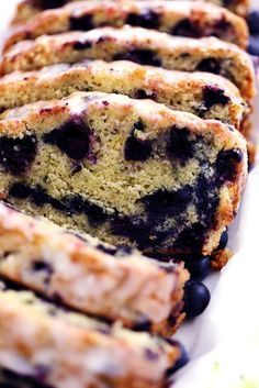 Blueberry Zucchini Bread with a Lemon Glaze will be one of the best quick breads you EVER make! Perfectly moist with two cups of zucchini hidden inside and bursting with fresh blueberries. The lemon… Healthy Bread Recipes, Gourmet Recipes, Baking Recipes, Dessert Recipes, Meat Recipes, Seafood Recipes, Lemon Recipes, Noodle Recipes, Muffin Recipes