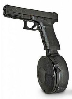 50 Round Drum for Glock It may look stupid or a little dumb but would you rather get one with no drum or get a drum with 50 rounds awesome. Becoz reloading is for pussies! Glock 9mm, Cool Guns, Awesome Guns, Home Defense, Guns And Ammo, Tactical Gear, Shotgun, Bang Bang, Firearms