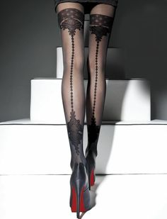 black tights with pattern on back..and let's not forget the sky-high stilettos!