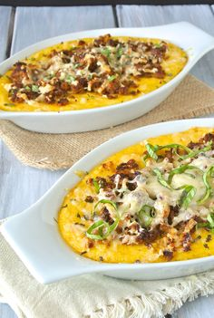 3 cheese polenta with Italian sausage. Creamy polenta is mixed with 3 cheeses and topped with Italian sausage, more cheese and fresh basil.