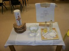 Baptism lesson for Godly Play using simple glass bottles and dishes