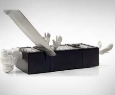 Show people you mean business by cutting someone in half while you sharpen your knives with this novelty magic trick knife sharpener. This knife sharpener is a tribute to the old magician's who would saw their assistant in half.