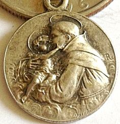 Vintage Signed Religious Medal Saint Anthony Jesus (Image1) Small signed holy medal with great detail featuring St. Anthony and the Christ child Jesus. Perfect size for a charm bracelet, just over 1/2 inch wide