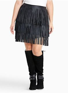 """As tempting as it is to stay spinning in this mini skirt, you might make yourself dizzy! The sleek and slimming black faux leather underlay is curve-hugging. Carefully detailed with allover faux leather fringe, we're telling you, you won't stop spinning.<div><ul><li style=""""LIST-STYLE-POSITION: outside !important; LIST-STYLE-TYPE: disc !important"""">Size 14 measures 22"""" from center front</li><li style=""""LIST-STYLE-POSITION: outside !important; LIST-STYLE-TYPE: disc !important"""">Imported plus size…"""