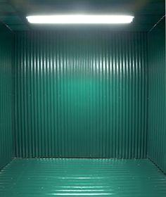 "Charles Harlan,Green Room, 2006.Corrugated fiberglass, fluorescent light fixture. 96 x 120 x 144"". Courtesy of the artist andJTT Gallery, NY."